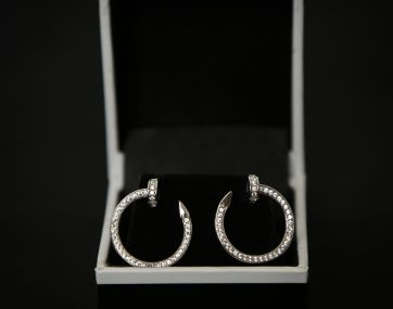 Rhodium plated Silver `nail` style earrings set with Cubic Zirconia.